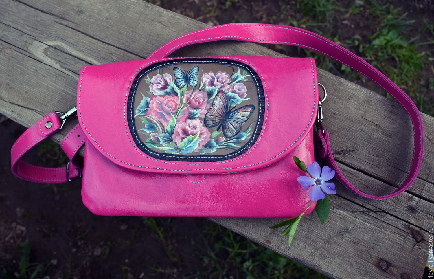 Bright handbag colours `fuchsia`. In stock. Roses and butterflies, painted and embossed. The handbags, like `Africa` two compartments and a pocket between them two pockets on lining. Handle length 110