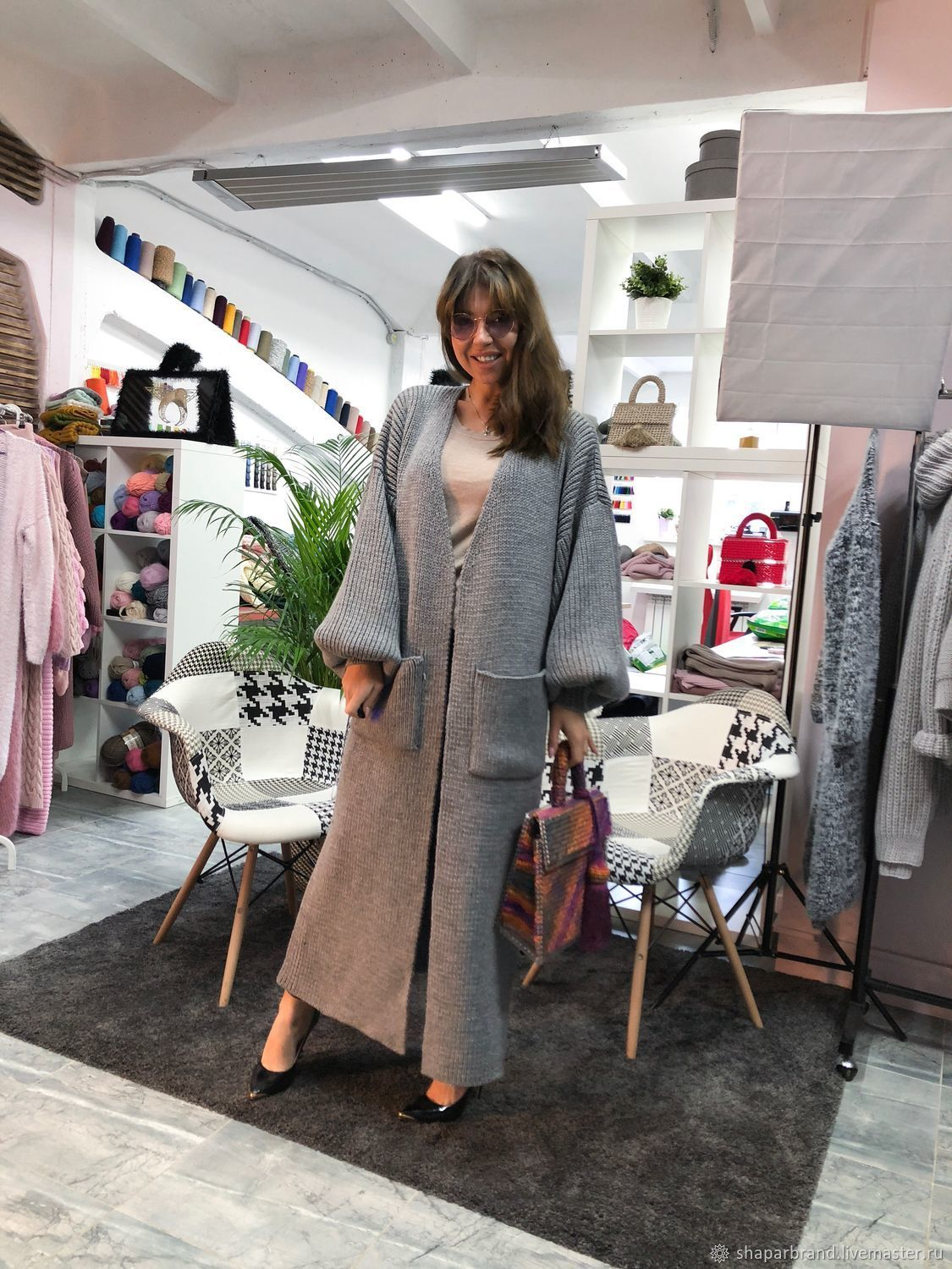 In pictures of women's long cardigan with pockets from Shapar, Brenda J. Ojeda women knitted handmade
