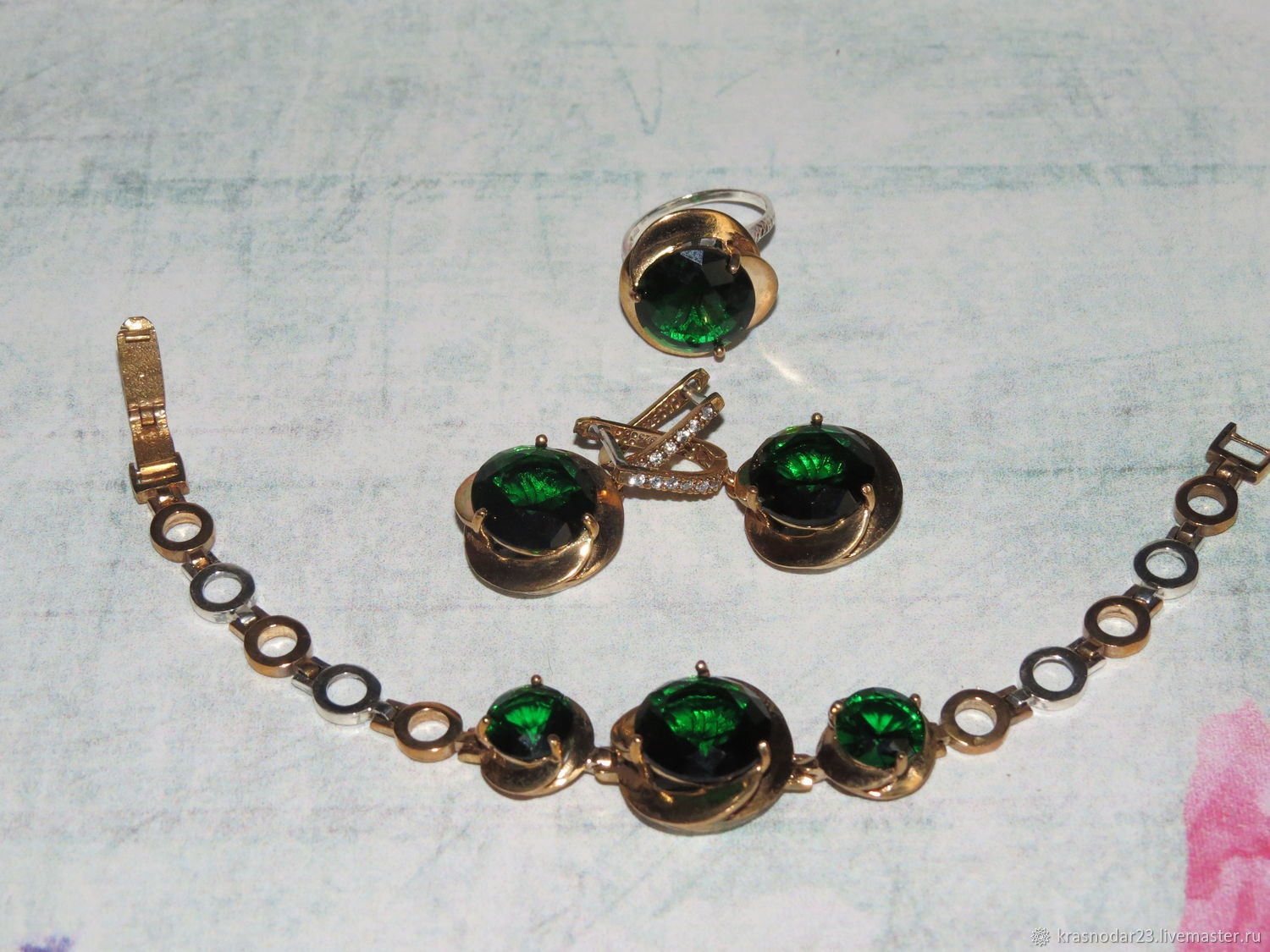 A set of 925 sterling SILVER with 24 carat gold plated embellished with quartz bright emerald green and zircons.